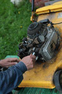 mechanic working on a lawnmower